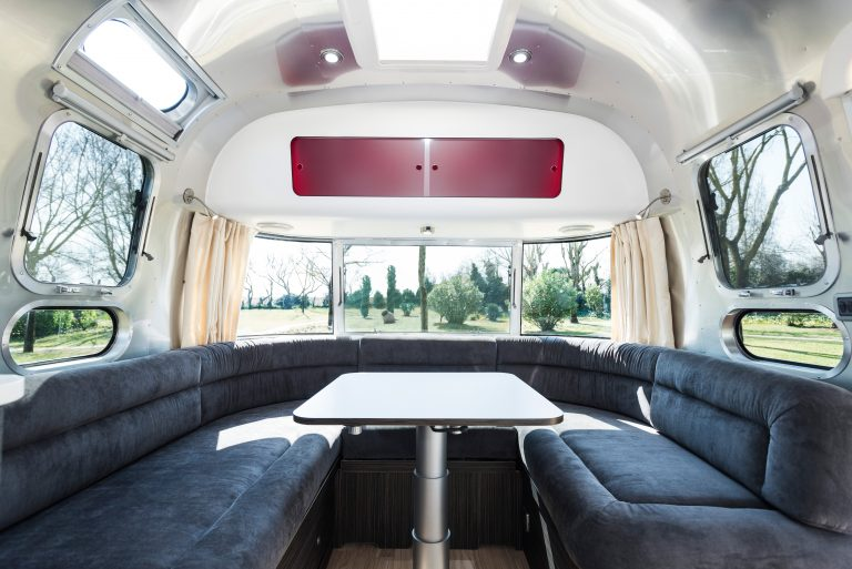 airstream interior with a big sofa and windows