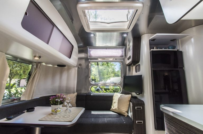 new age airstream with a table an glass of water