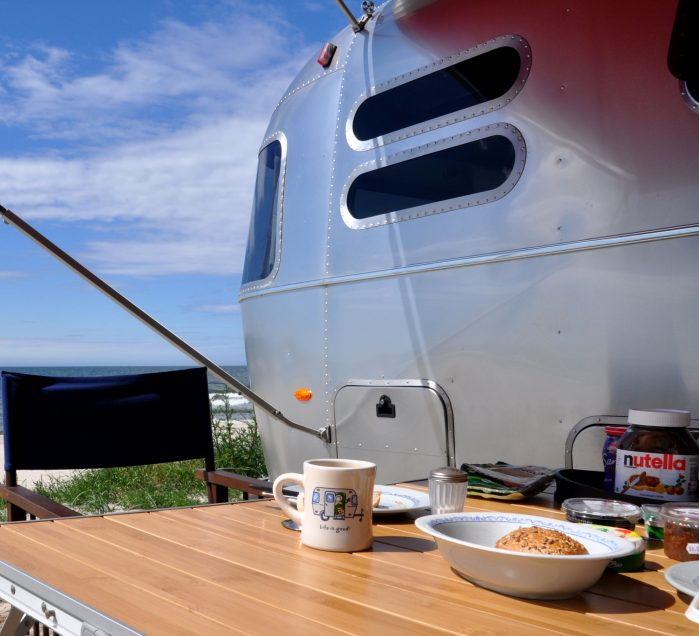 an airstream breakfast with coffee and delicious biscuits